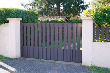 Metal driveway entrance gates house garage in suburb