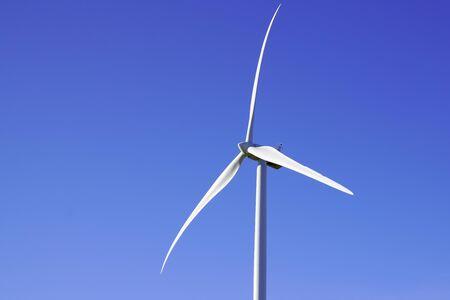 wind Turbine Green Energy Electricity Technology energy farm against blue clear sky 스톡 콘텐츠