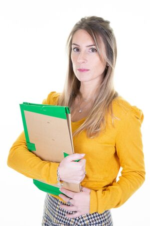 Young business woman over isolated white background with arms crossed aside looking forward