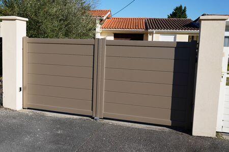 Aluminum brown house garden gate Reklamní fotografie