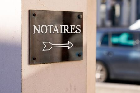 notary arrow board sign logo entrance building office for french Notaire