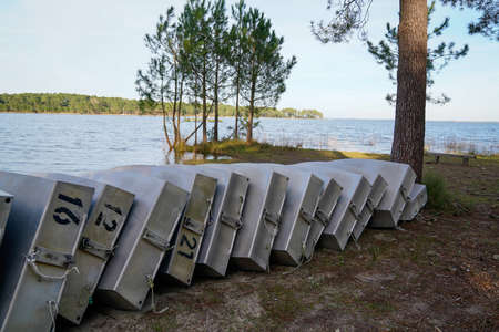 small learning school boat overturned Rowboats On Dock sand lake beach