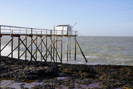 white wooden hut cabin for fisherman in river garonne Meschers sur Gironde atlantic coast France