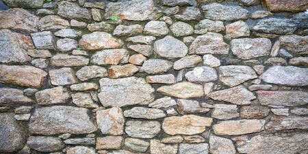 Old beautiful grey rustic background stone wall several shades of gray Banque d'images - 140990369