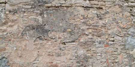 Old stone damaged ancient brick wall texture background Banque d'images - 140990344