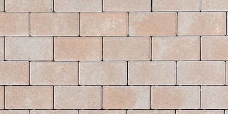 Textured stone tilled wall texture masonry brick abstract background of sandstone facade for wallpaper Banque d'images - 140990116