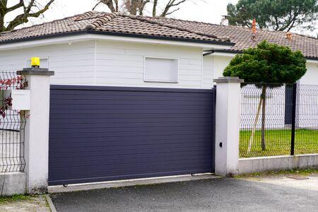 gray aluminum gate portal of suburb house