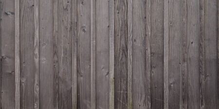 Gray wooden background with old grey wood painted boards wallpaper plank close up texture