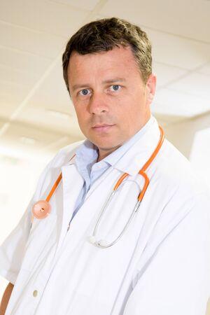 Handsome serious Doctor at hospital waiting for Coronavirus disease COVID-19 patient 版權商用圖片