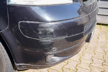 van bumper with scratch damaged broken car scratched paint in accident collision street Foto de archivo