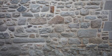 Grey stone wall old stones gray assembled texture ancient background