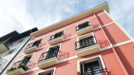 restored white and red house in the colors of the basque country in bayonne France