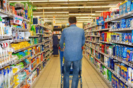 Bordeaux , Aquitaine / France - 03 30 2020 : Back of man walking in supermarket with shopping cart Editorial