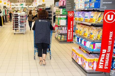Bordeaux , Aquitaine / France - 03 30 2020 : hyper u woman worker interior hypermarket super supermarket with shopping cart