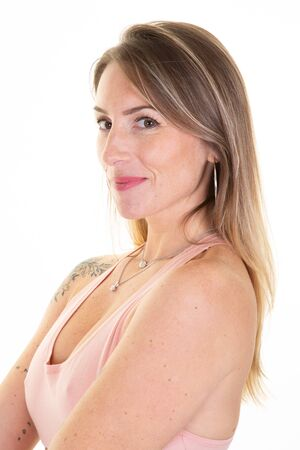 Beautiful woman tatoo over isolated white background with serious sad expression on face natural looking at camera