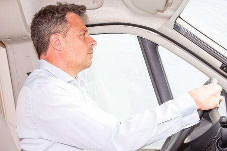 handsome man profil in van portrait of businessman driving car