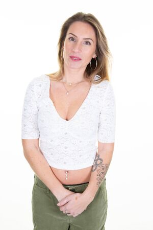 Smiling business tatoo blonde woman standing in white wall office