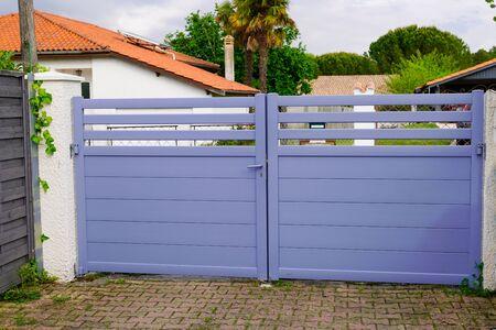 modern grey gate aluminum portal with blades suburbs house street