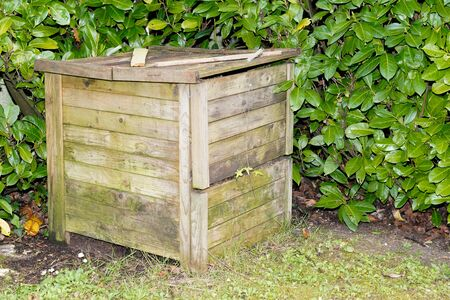 home garden wooden compost ecological bin with organic material outdoor house