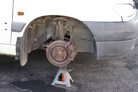 Car old used brake disk and tyre change front automobiles repair shop