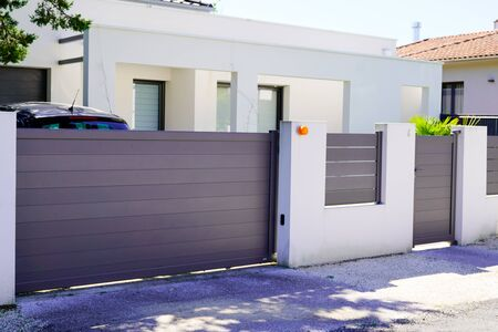 street suburb home grey brown dark metal aluminum house gate slats garden access door Stock fotó