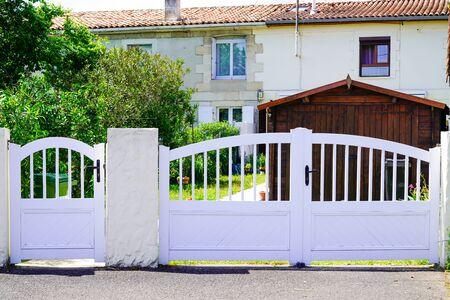 home double white metal aluminum house gate door with two entrance Foto de archivo