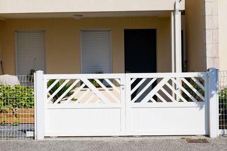 white classic entrance portal home metal door aluminum gate of modern house Foto de archivo