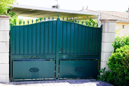 street vintage home green door in dark metal retro house gate to garden access