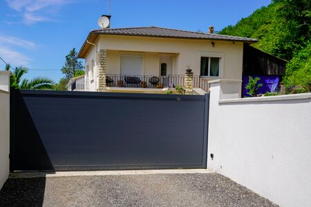 Aluminum dark gray metal gate to house with portal black to access home