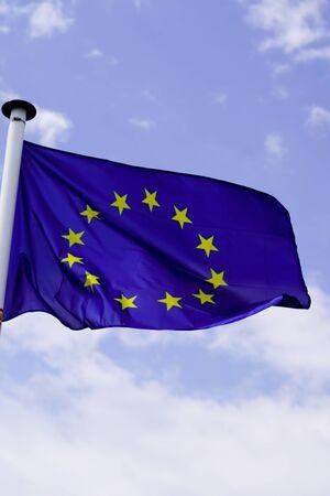 blue flag of European Union EU in blue sky in mat