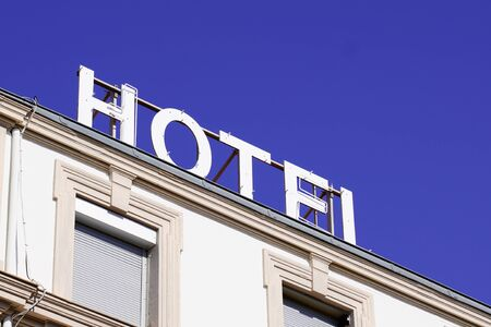 Hotel sign text on roof Building in tourist city