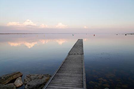 sunrise reflexion on fishing boat wooden pontoon in sunset Lake of sanguinet france