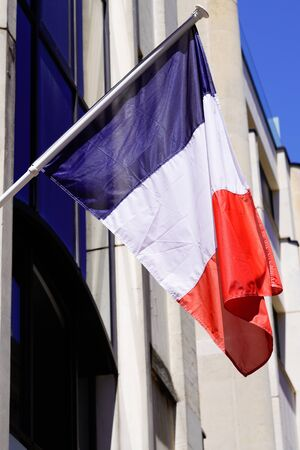 french blue white red flag of france on city hall building