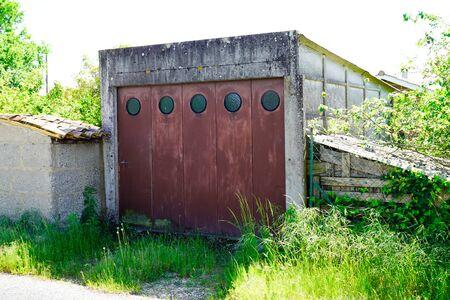 old rust metal garage doors closed