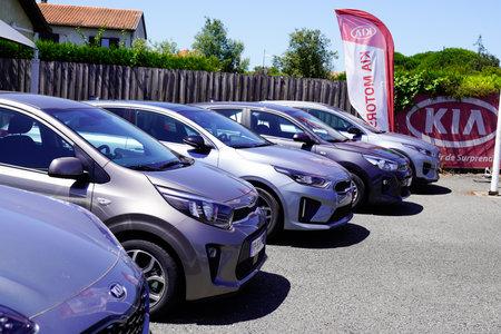 Bordeaux , Aquitaine / France - 06 20 2020 : Kia Automobiles shop parked car front of Dealership logo Store sign