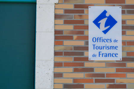 office de tourisme logo sign on wall building of information center in french for tourist tour help