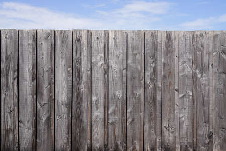 wooden wall fence plank background and cloudy sky for wallpaper Imagens