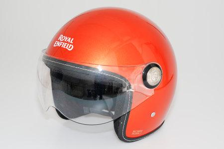 Bordeaux , Aquitaine / France - 07 05 2020 : Royal Enfield logo sign on retro orange helmet safety worn to protect motorbike man head