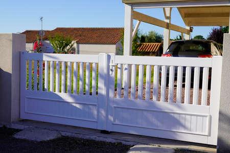 white street home door pvc plastic gate slats portal of suburb house Archivio Fotografico