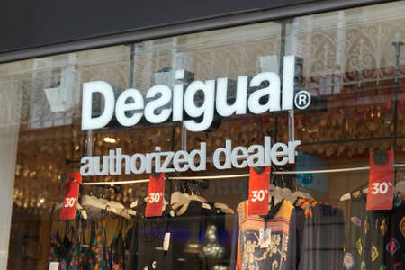 Bordeaux, Aquitaine / France - 07 25 2020: Desigual authorized dealer logo and text sign on windows shop facade of spanish store clothing brand