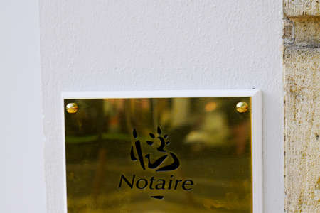 Bordeaux, Aquitaine / France - 07 28 2020: notary office golden entrance plate in wall entrance building of french Notaire