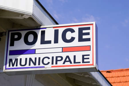 police municipale means in french Municipal police Station with flag and text sign