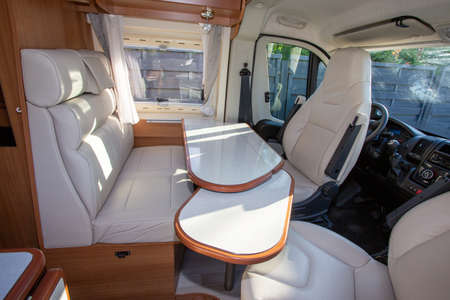 vacation campervan with white luxury interior table wooden and seat in modern new motor home for vanlife concept