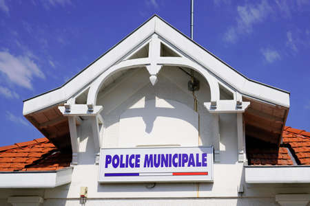 police municipale means in french Municipal police in official building in city with logo text sign Banco de Imagens
