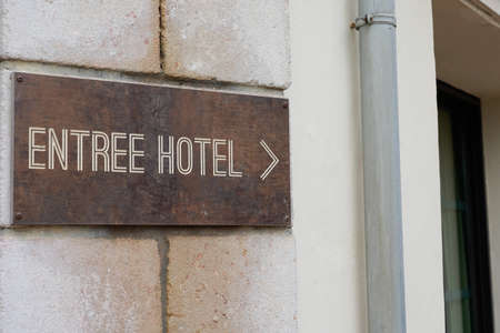 entree hotel means in french entrance to hotel sign text on old panel in tourist city Banque d'images
