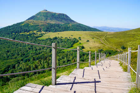 wooden staircase for access to the Puy de Dôme volcano in Auvergne france