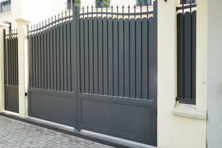 steel gray gate aluminum portal of suburb home