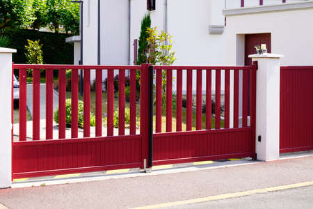 Aluminum dark red metal gate of suburb house steel door Stock fotó