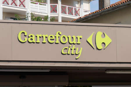 Bordeaux, Aquitaine / France - 07 30 2020: Carrefour city logo and green text sign for store entrance supermarket shop of french town center