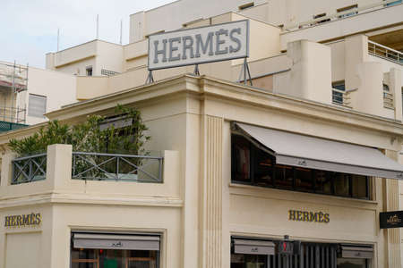 Biarritz, Aquitaine / France - 07 30 2020: Hermès logo and text sign on store building roof of French high fashion shop luxury goods manufacturer Hermes for leather lifestyle accessories